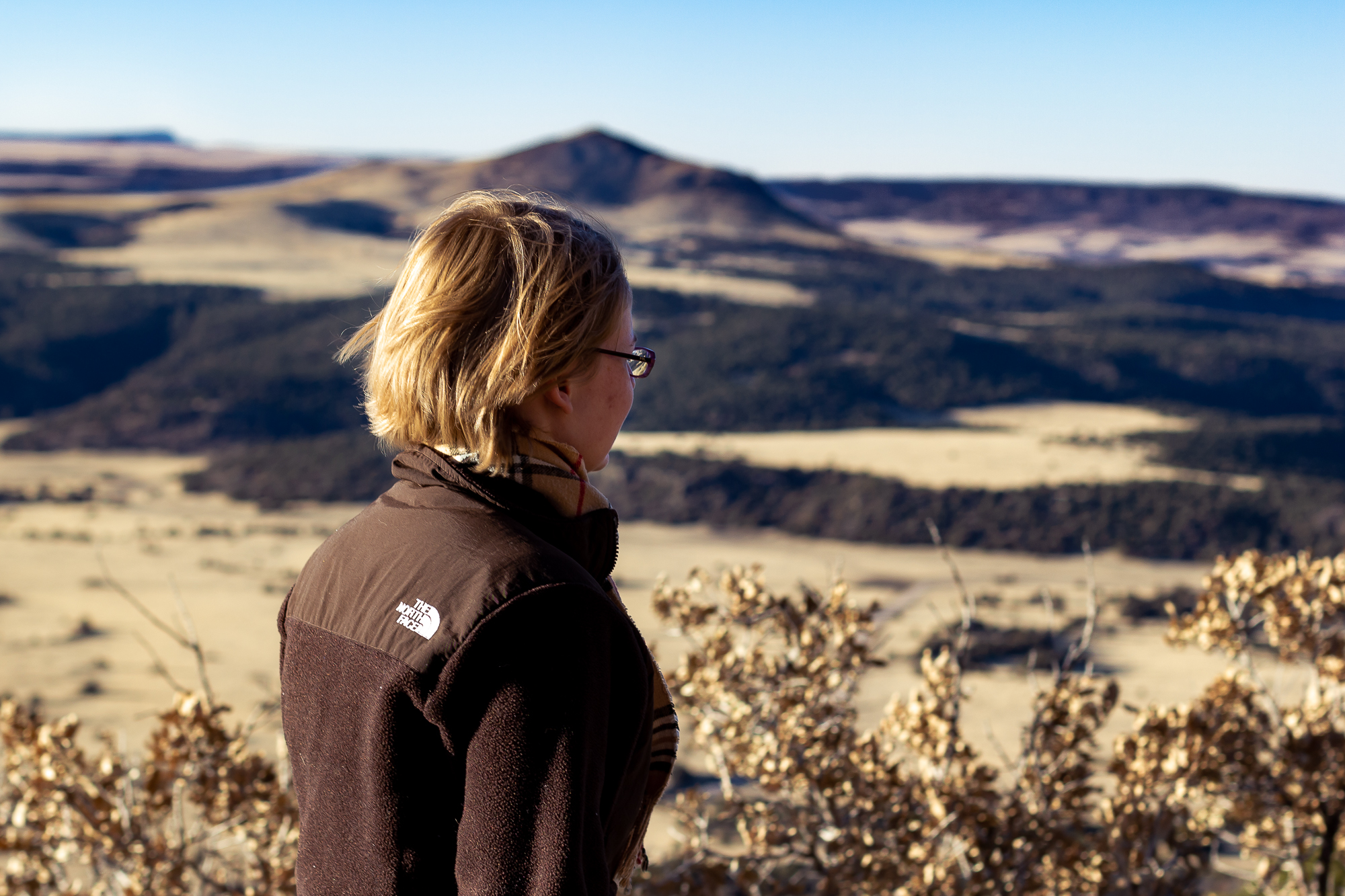 Young woman looking out from the top of Capulin Volcano in New Mexico